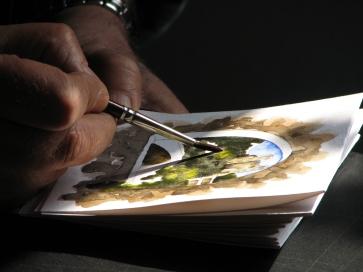 dolceacqua43_-_artista_locale_mentre_dipinge_un_acquarello-pub-domain