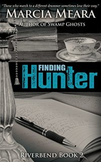 Book cover for Finding Hunter by Marcia Meara shows open journal with pen, cup of tea in backgroud